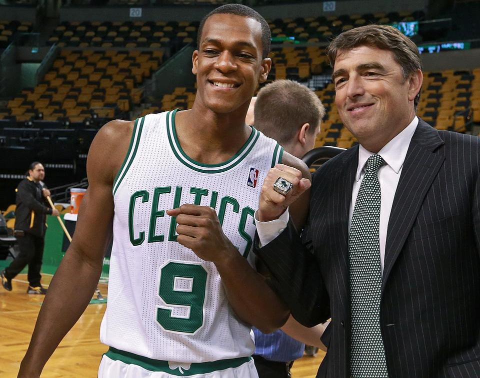 Wyc Grousbeck, right, with Rajon Rondo.